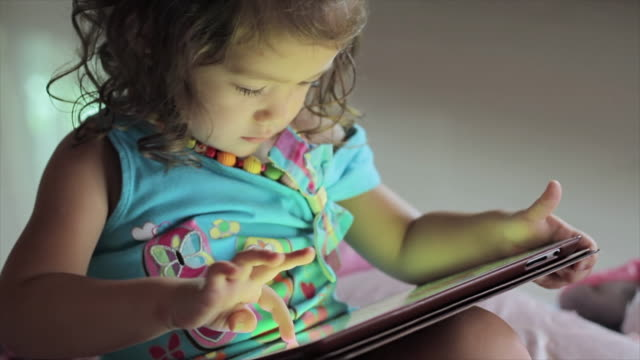 little girl playing with a digital tablet - baby girls stock videos & royalty-free footage