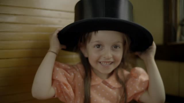 little girl playing with a top hat on a train - top hat stock videos & royalty-free footage