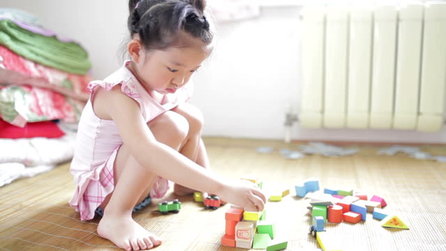 Little girl playing with blocks at home /Xi'an, Shaanxi, China