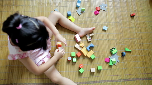 HA Little girl playing with blocks at home  /Xi'an, Shaanxi, China
