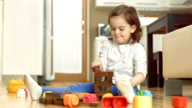 little girl playing with blocks - toy block stock videos and b-roll footage