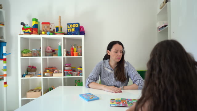 little girl playing with educational toys at occupational therapist office - invisible disability stock videos & royalty-free footage