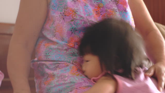 little girl playing with grandmother at home - shy stock videos & royalty-free footage