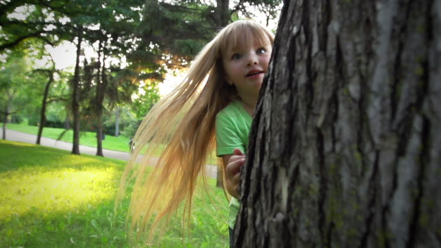 little girl plays hide and seek - hide and seek stock videos & royalty-free footage