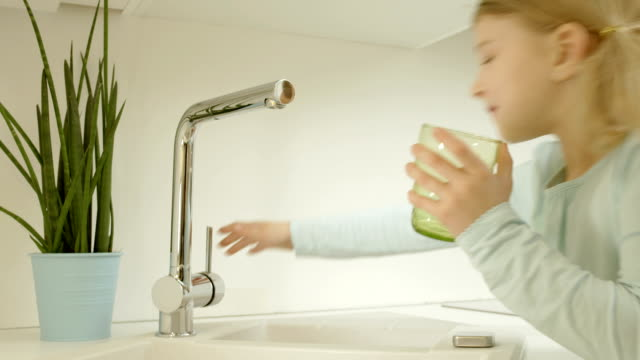 little girl pouring tap water - tap stock videos & royalty-free footage