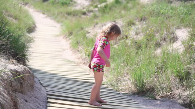 ms little girl practicing dance moves and yoga on boardwalk / toronto, ontario, canada - kelly mason videos stock videos & royalty-free footage