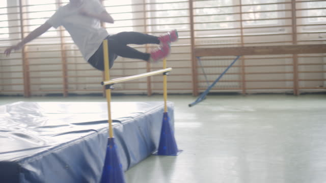 4k: little girl practicing high jump. - athlete stock videos & royalty-free footage