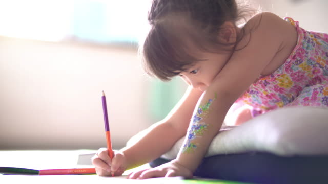 little girl practicing writing at home - human face drawing stock videos & royalty-free footage