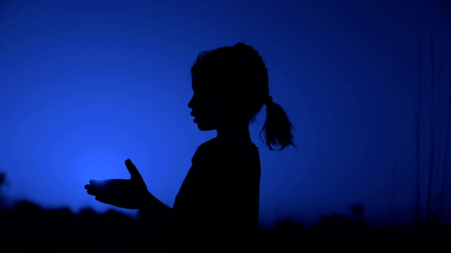 little girl praying silhouette - indian culture stock videos & royalty-free footage