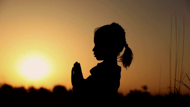little girl praying silhouette - forgiveness stock videos and b-roll footage