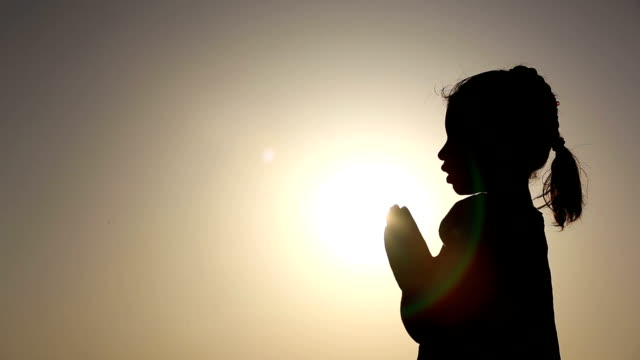 little girl praying silhouette - praying stock videos & royalty-free footage