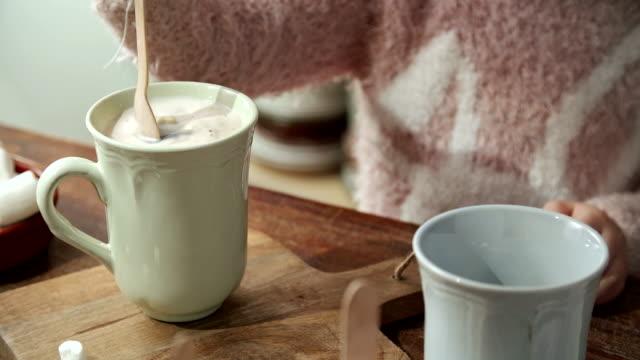 Little Girl Preparing Hot Chocolate
