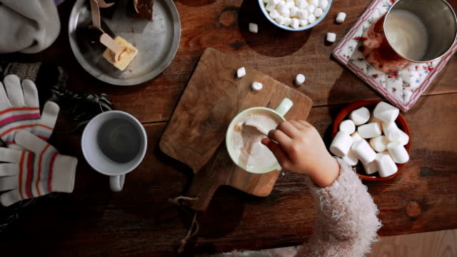 little girl preparing hot chocolate - hot chocolate stock videos and b-roll footage