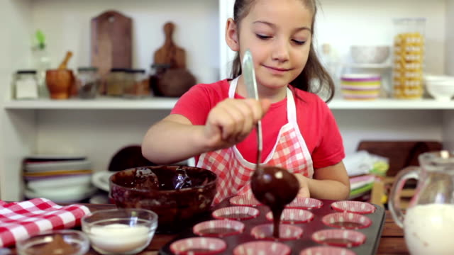 little girl preparing muffins - muffin stock videos and b-roll footage