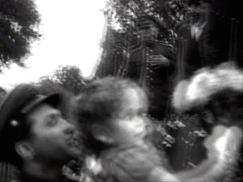 stockvideo's en b-roll-footage met little girl presenting flowers to nikita khrushchev during wartime communist meeting in 1943 - 1943