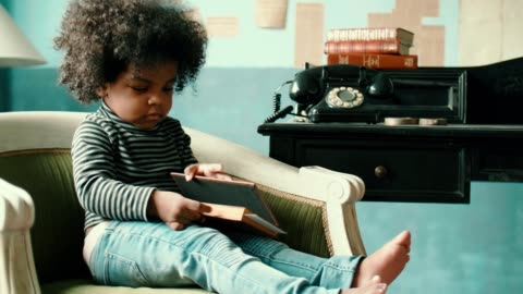 little girl reading a book story - 2 3 years stock videos & royalty-free footage
