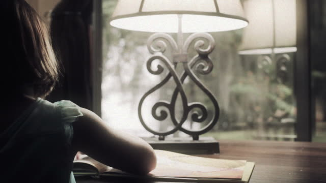 little girl reads a book - electric lamp stock videos & royalty-free footage