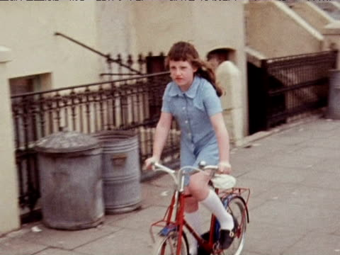 little girl rides bicycle down notting hill street; 1971 - childhood stock videos & royalty-free footage