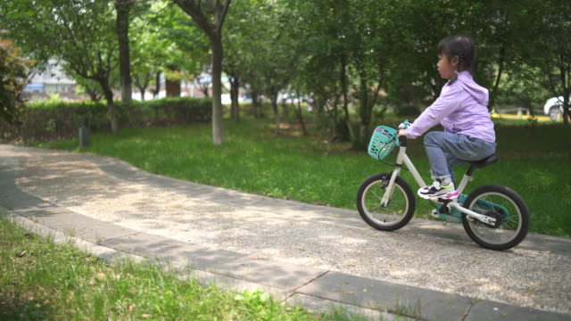 little girl riding a bicycle - lockdown viewpoint stock videos & royalty-free footage