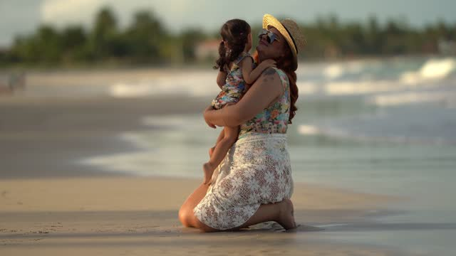little girl running to hug her mother on the beach - swimming costume stock videos & royalty-free footage