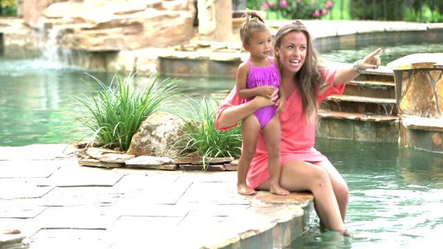 vídeos de stock e filmes b-roll de little girl running to mother's open arms, on vacation - water's edge