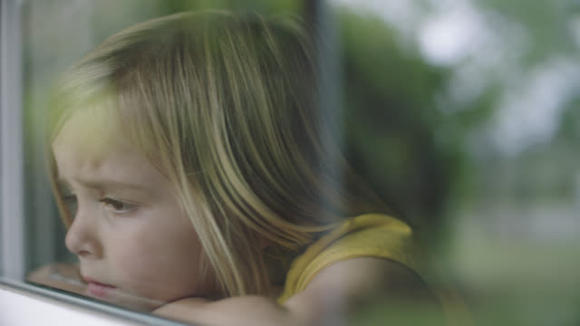 slo mo. cu of little girl sad she cant go outside. - headshot stock videos & royalty-free footage