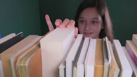 little girl selects book - choice stock videos & royalty-free footage