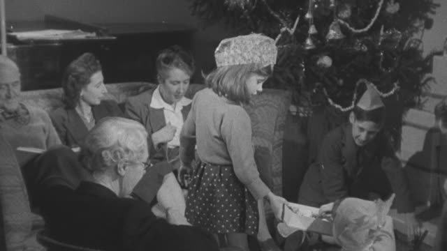 1947 montage little girl serving holiday cookies / united kingdom - biscuit stock videos & royalty-free footage