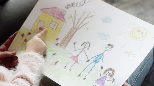 little girl showing drawings to her parents - preschool child stock videos & royalty-free footage