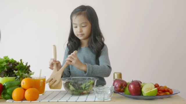 little girl showing how to cooking salad - making salad stock videos & royalty-free footage