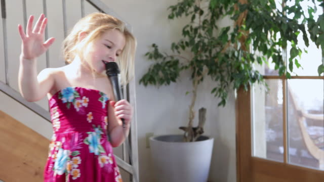 ms td tu little girl singing and dancing with microphone / lamy, new mexico, united states - singing stock videos & royalty-free footage
