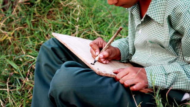 little girl sitting in the field and studying outdoor portrait - pen and ink stock videos & royalty-free footage