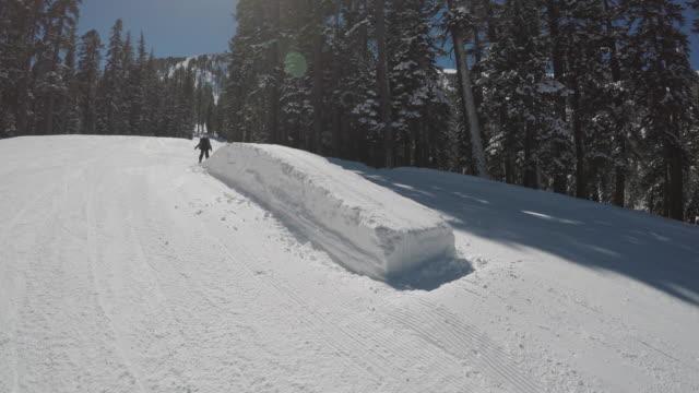 little girl skiing in terrain park