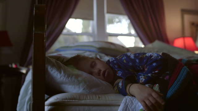 cu little girl sleeping in bed / los angeles, california, united states - sleeping stock videos & royalty-free footage