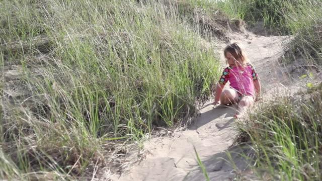 ms ts little girl sliding down sand dune / toronto, ontario, canada - kelly mason videos stock videos & royalty-free footage