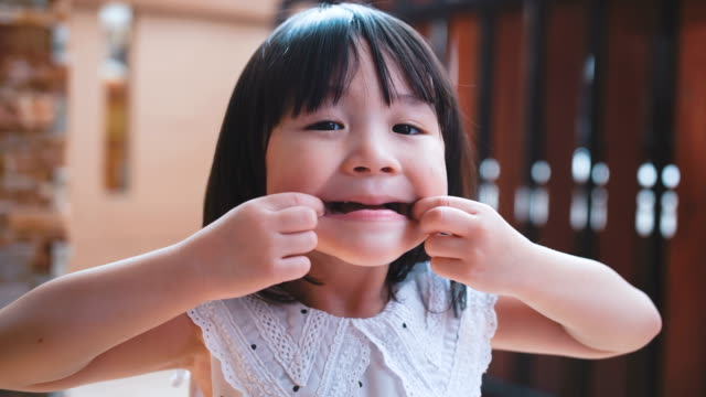 little girl smiling - pulling funny faces stock videos & royalty-free footage