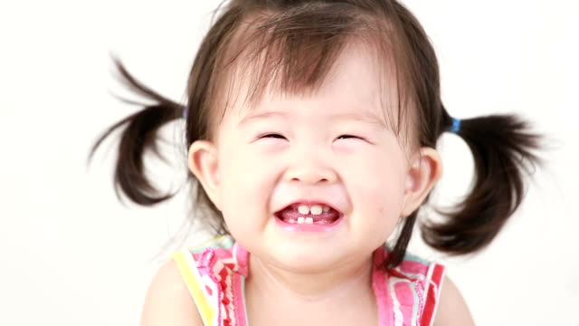 little girl smiling - baby girls stock videos & royalty-free footage
