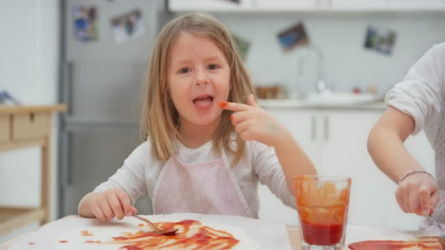 ld little girl smiling while trying the tomato sauce for her pizza - sucking stock videos & royalty-free footage