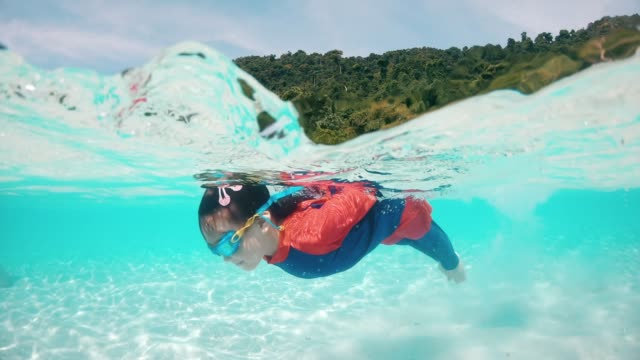 little girl snorkeling in thailand beach - tropical climate stock videos & royalty-free footage