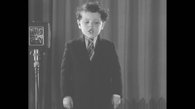 """little girl; sot """"albert will sing, 'jesus loves me'"""" / mls boy albert stands on stage next to nbc microphone on stand, rear view of audience in... - incomplete stock videos & royalty-free footage"""