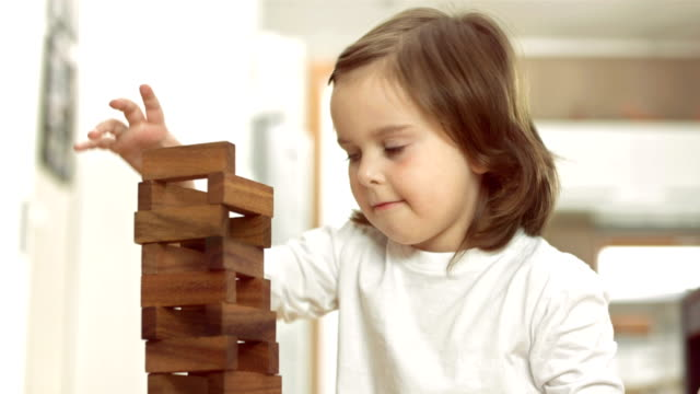 little girl stacking blocks - toy block stock videos and b-roll footage