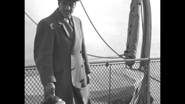 little girl standing next to legs of boxer primo carnera he holds her hand pan up to his face / cu carnera aboard ship buildings in distance he takes... - primo carnera stock videos and b-roll footage