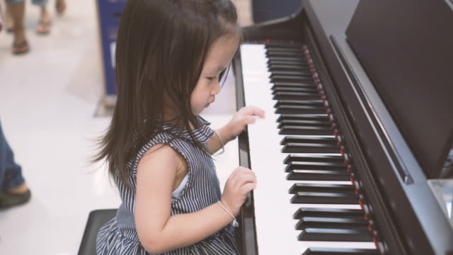 little girl start playing piano - 2 3 years stock videos and b-roll footage