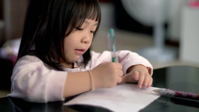 little girl(4-5 years) study and learning writing on paper - studio camera video stock e b–roll