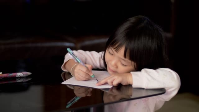 Little girl(4-5 years) study and learning writing on paper