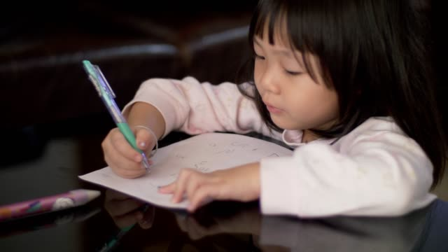 little girl(4-5 years) study and learning writing on paper - textbook stock videos & royalty-free footage