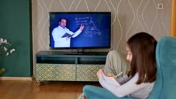 little girl studying distance education at home