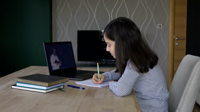 little girl studying distance education at home - laptop isolated stock videos & royalty-free footage