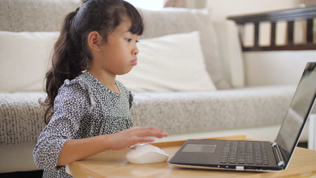 little girl studying online from home by laptop - little girl webcam stock videos & royalty-free footage