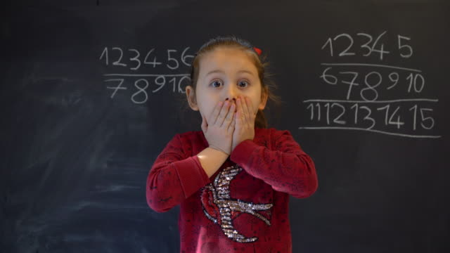 little girl surprised over blackboard - surprise stock videos & royalty-free footage